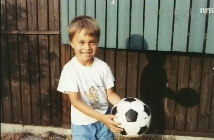 Alex with a football